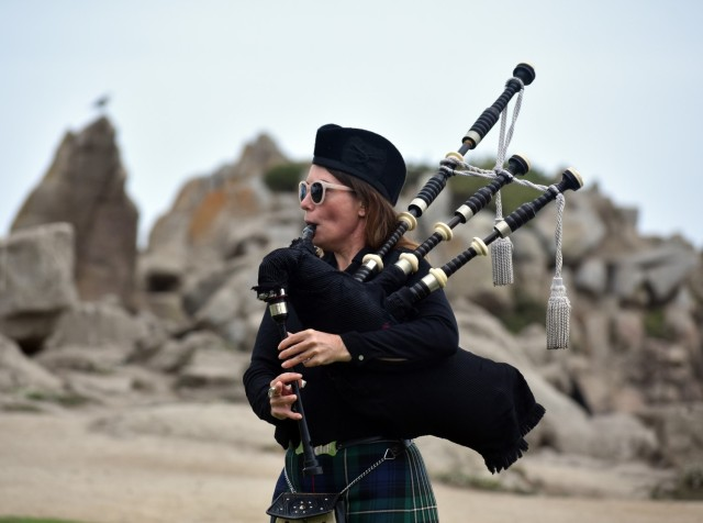 """Kasie Talbot plays the bagpipes at Lovers Point Park, Pacific Grove, Calif., Sept. 17, before the """"Afghanistan Servicemembers Memorial"""" for the 13 service members killed in action at the Kabul Airport on Aug. 26."""