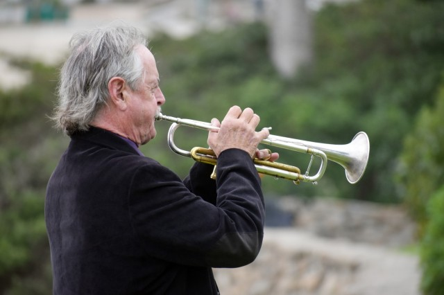 """Brian Stock plays taps at Lovers Point Park, Pacific Grove, Calif., Sept. 17, during the """"Afghanistan Servicemembers Memorial"""" for the 13 service members killed in action at the Kabul Airport on Aug. 26."""