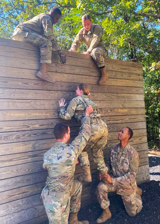 Cadet Brooke Payne works with her team to complete the confidence course Sept. 18 at Training Area 97, as part of the Army ROTC Gateway Battalion's fall FTX.