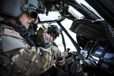 Army Black Hawk pilots prepare for flight.