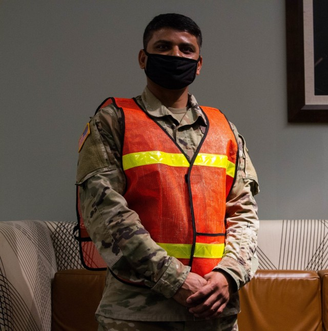 Sgt. Sagar Patel, a cargo specialist with the 129th Combat Support Sustainment Brigade, is a liaison officer (LNO) assisting with Afghan personnel at Fort Lee, Virginia, Sept. 20, 2021. The Department of Defense, through U.S. Northern Command, and in support of the Department of Homeland Security, is providing transportation, temporary housing, medical screening, and general support for at least 50,000 Afghan evacuees at suitable facilities, in permanent or temporary structures, as quickly as possible. This initiative provides Afghan personnel essential support at secure locations outside Afghanistan. (U.S. Army photo by Sgt. Andre Taylor)