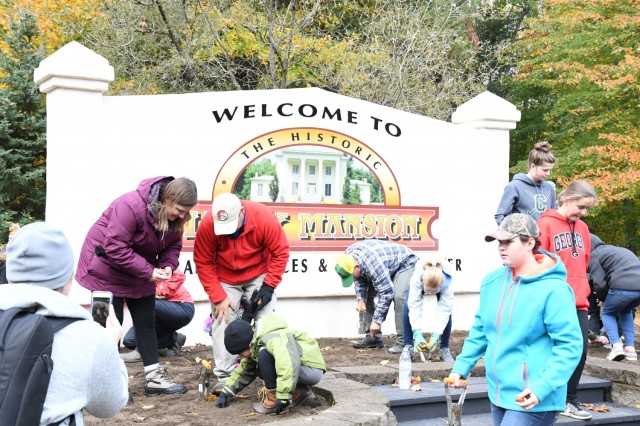 Community members gathered at LeRay Mansion in October 2018 for the inaugural Beautify LeRay Day event, where volunteers planted dozens of trees and flower beds throughout the historic district.  Volunteers make the heart of a community beat, and the Fort Drum Army Volunteer Corps helps community members find opportunities to give of their time and energy in meaningful ways.  (Photo by Mike Strasser, Fort Drum Garrison Public Affairs)