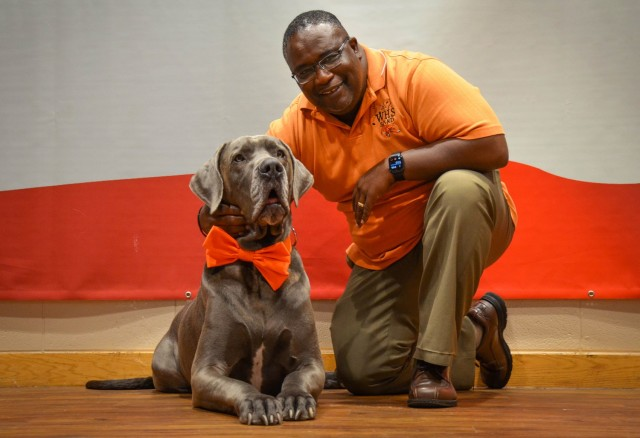 Johnnie Bryant poses with Maverick, one of the therapy animals at the Fort Leonard Wood USO. Bryant is a retired sergeant first class and former trainee and drill sergeant here, who now works as a housing manager for the Directorate of Public Works while also donating his time as a highly-active volunteer at the USO. He has been recognized as the Waynesville-St. Robert Chamber of Commerce 2021 Veteran of the Year for his contributions to the Fort Leonard Wood community, and will act as Parade Marshal during the Waynesville-St. Robert Veterans Day parade, set to begin at 11 a.m. Nov. 11 at the St. Robert Municipal Center parking lot.