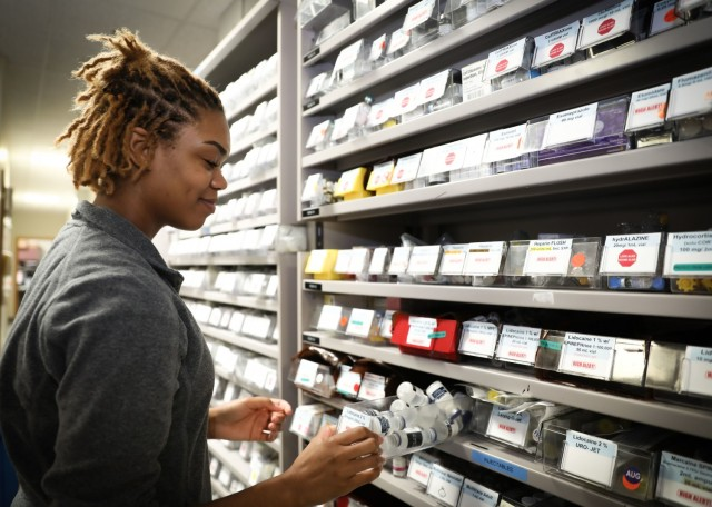 U.S. Air Force Senior Airman Amber Lash, pharmacy technician, Inpatient Pharmacy, Landstuhl Regional Medical Center, sorts through pharmacy supplies at LRMC, Aug 9. Lash was recently recognized for life-saving efforts while on leave in Seattle. During a family outing, Lash, a native of Detroit, was essential in responding to a sudden cardiac arrest where Lash performed CPR for approximately 20 minutes, reviving the casualty.