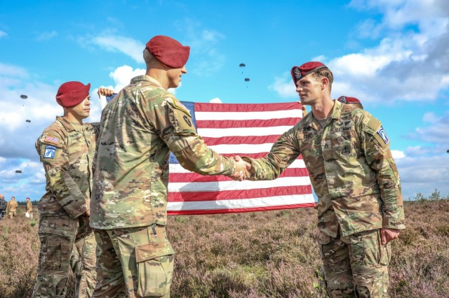 Staff Sgt. David Cobb, right, assigned to the 143rd Infantry Regiment (Airborne), reenlists at the Houtdorpveld drop zone during Falcon Leap, NATO's largest Airborne technical exercise, in the Netherlands Sept. 16, 2021.
