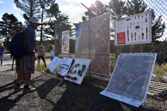 A hiker looks at interpretive information before the start of a guided nature walk inside the Fort Ord Impact Area, Fort Ord National Monument, Calif., Sept. 18.