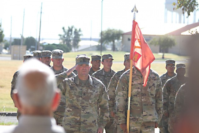 1st Sgt. Casey McCrady, A Battery's new first sergeant, salutes Capt. Catherine Grizzle at the conclusion of the change of responsibility ceremony Sept. 22, 2021, at Fort Sill, Oklahoma.