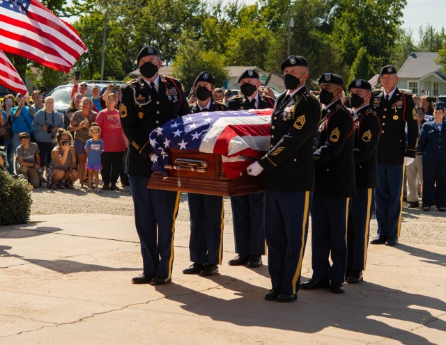 Soldiers from the 1st Infantry Division provide military funeral honors for Chaplain (Capt.) Emil J. Kapaun at St. John Nepomucene Catholic Church in Pilsen, Kan., Sept. 25, 2021. In May, the Defense POW/MIA Accounting Agency fully identified Kapaun's remains, who previously served with the 3rd Battalion, 8th Cavalry Regiment, 1st Cavalry Division during the Korean War. He was posthumously awarded the Medal of Honor in 2013 for his actions overseas.   In March, the Defense POW/MIA Accounting Agency identified Kapaun's remains, who previously served with the division's 3rd Battalion, 8th Cavalry Regiment during the Korean War. He was posthumously awarded the Medal of Honor in 2013 for his actions overseas.