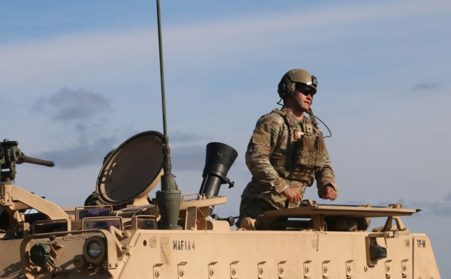 A Soldier assigned to the mortar section of 3rd Battalion, 67th Armored Regiment, 2nd Armored Brigade Combat Team, 3rd Infantry Division, asks for a count of remaining 120mm rounds at OP4 on Fort Stewart, Georgia, Sept. 15, 2021. The mortar section in the headquarters and headquarters company must go through the mortar evaluation program, or MORTEP, in order to become certified on their weapon system for effective indirect fires in combat operations. (U.S. Army photo by Staff Sgt. Todd L. Pouliot, 50th Public Affairs Detachment)