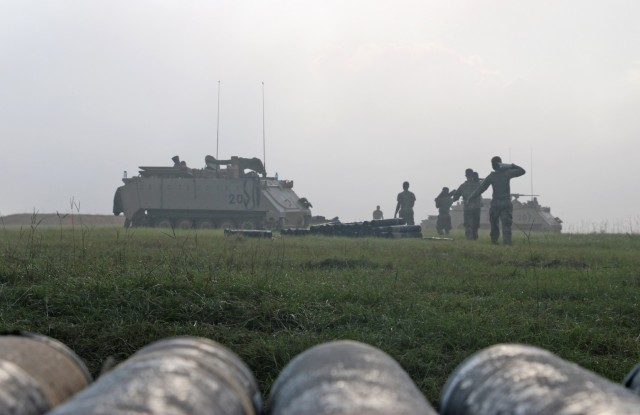 Soldiers assigned to the mortar section of 3rd Battalion, 67th Armored Regiment, 2nd Armored Brigade Combat Team, 3rd Infantry Division, carry 120mm training rounds to their M113 tracked vehicles at OP4 on Fort Stewart, Georgia, Sept. 15, 2021. The mortar section in the headquarters and headquarters company must go through the mortar evaluation program, or MORTEP, in order to become certified on their weapon system for effective indirect fires in combat operations. (U.S. Army photo by Staff Sgt. Todd L. Pouliot, 50th Public Affairs Detachment)