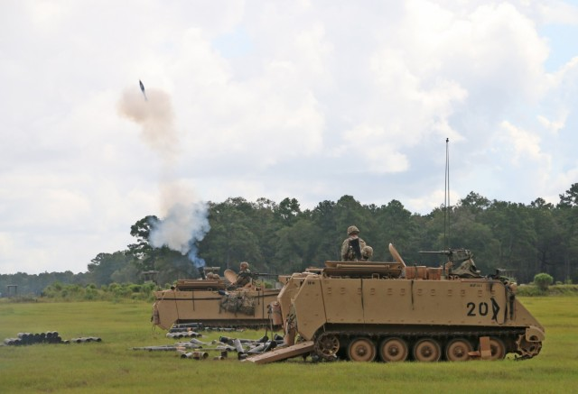 Soldiers assigned to the mortar section of 3rd Battalion, 67th Armored Regiment, 2nd Armored Brigade Combat Team, 3rd Infantry Division, ire a volley of 120mm rounds toward a target at OP4 on Fort Stewart, Georgia, Sept. 15, 2021. The mortar section in the headquarters and headquarters company must go through the mortar evaluation program, or MORTEP, in order to become certified on their weapon system for effective indirect fires in combat operations. (U.S. Army photo by Staff Sgt. Todd L. Pouliot, 50th Public Affairs Detachment)