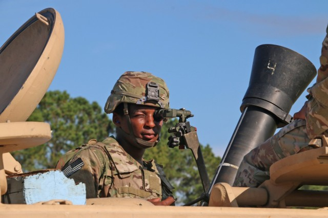 A Soldier assigned to the mortar section of 3rd Battalion, 67th Armored Regiment, 2nd Armored Brigade Combat Team, 3rd Infantry Division, checks the sites of his squad's 120mm mortar at OP4 on Fort Stewart, Georgia, Sept. 15, 2021. The mortar section in the headquarters and headquarters company must go through the mortar evaluation program, or MORTEP, in order to become certified on their weapon system for effective indirect fires in combat operations. (U.S. Army photo by Staff Sgt. Todd L. Pouliot, 50th Public Affairs Detachment)