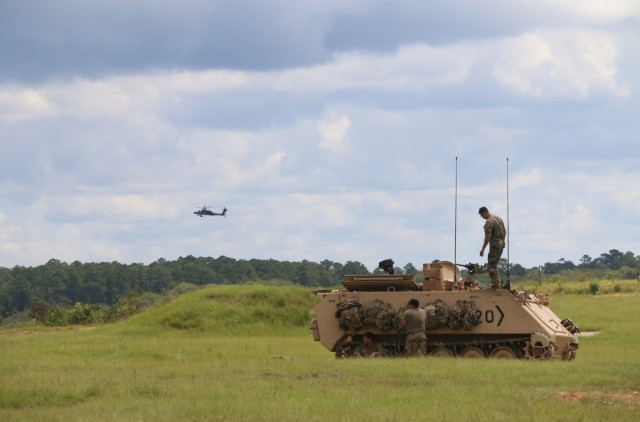 Soldiers assigned to 3rd Battalion, 67th Armored Regiment, 2nd Armored Brigade Combat Team, 3rd Infantry Division, prepare their M113 tracked vehicle for an iteration of mortar live fire exercises at Fort Stewart, Georgia, Sept. 15, 2021. The mortar section in the headquarters and headquarters company must go through the mortar evaluation program, or MORTEP, in order to become certified on their weapon system for effective indirect fires in combat operations. (U.S. Army photo by Staff Sgt. Todd L. Pouliot, 50th Public Affairs Detachment)