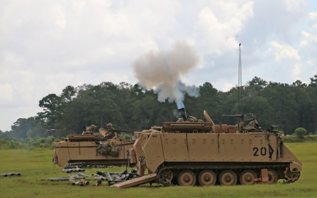 Soldiers assigned to the mortar section of 3rd Battalion, 67th Armored Regiment, 2nd Armored Brigade Combat Team, 3rd Infantry Division, fire a volley of 120mm rounds toward a target at OP4 on Fort Stewart, Georgia, Sept. 15, 2021. The mortar section in the headquarters and headquarters company must go through the mortar evaluation program, or MORTEP, in order to become certified on their weapon system for effective indirect fires in combat operations. (U.S. Army photo by Staff Sgt. Todd L. Pouliot, 50th Public Affairs Detachment)
