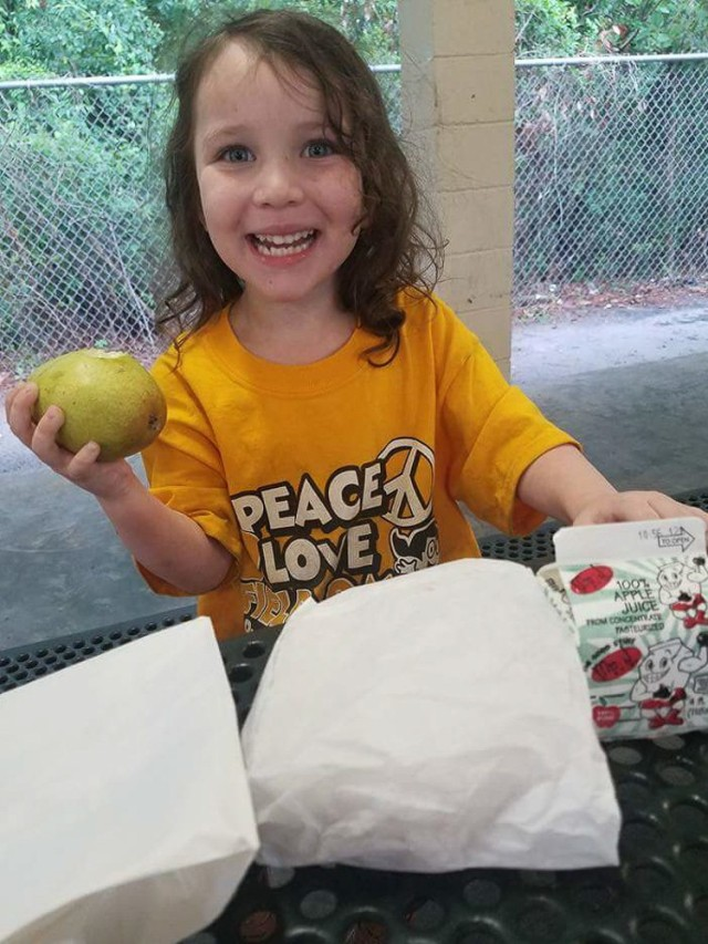 Magdylena Lopez, the daughter of an Army Soldier stationed at Hunter Army Airfield, enjoys a free lunch thanks to the Liberty County Summer Food Program June 8, 2017, in Hinesville, Ga. The Program helps provide meals to kids free of charge as part of the county's mission to alleviate food insecurity. Families are able to find a program site at many neighborhoods, parks, churches, and recreation centers throughout the county.