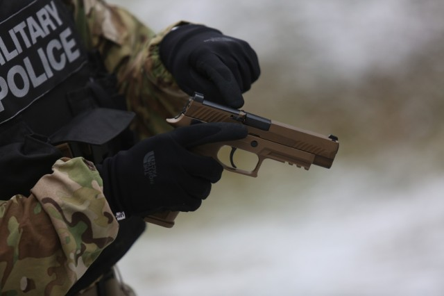 1st Lt. Anna Kretzer, a platoon leader assigned to the 527th Military Police Company, qualifies on the new M17. The U.S. Army started fielding Military Police units with the new SIG Sauer M17 pistol to replace the M9 Beretta.  (U.S. Army photo by Sgt. Tristin Maximilian)