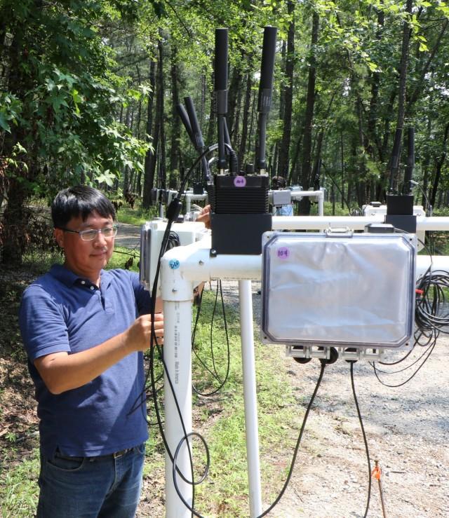 Army C5ISR Center electronics engineer Dan Ku works on radios during Network Modernization Experimentation 21 on July 7, 2021, at Joint Base McGuire-Dix-Lakehurst, N.J.