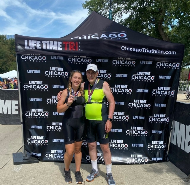 """First Lt. Victoria Falk, left, the human resource officer for the """"Hound Battalion,"""" 3rd Battalion, 67th Armor Regiment, 3rd Infantry Division, poses with her father, right, after competing together at the Chicago Triathlon, in Chicago, Illinois, Aug. 29, 2021.  The Chicago Triathlon was her first competition of this nature, consisting of consisted of a 1.5K swim, a 40K bike, and a 10K run, and a lifelong memory as she competed alongside her father. (Photo courtesy of 1st Lt. Victoria Falk, U.S. Army)"""