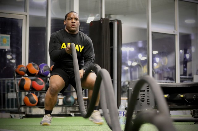 Army Reserve Sgt. Demos Moore, a chemical, biological, radiological and nuclear specialist assigned to the 377th Chemical Company, 485th Chemical Battalion, 76th Operational Response Command, works out with rope lines at a gym in Richmond, Virginia, February 18.  Moore, who once struggled with being overweight and out of shape has dedicated himself to physical fitness, losing more than forty-pounds in the past four months. (Official U.S. Army Reserve photo by Sgt. 1st Class Brent C. Powell)