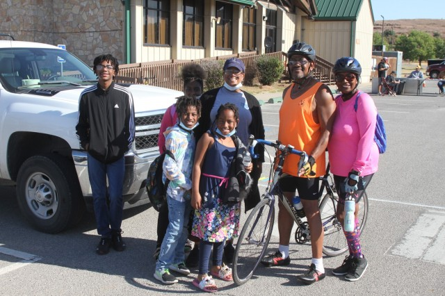 Thomas Thompkins, a retired Army staff sergeant from Lawton, relaxes with his daughter and grandchildren, and friend, Sheila Relf (right) after his 27-mile ride. He said he will probably ride the 2022 Tour de Sill and will prepare for one of the longer routes.