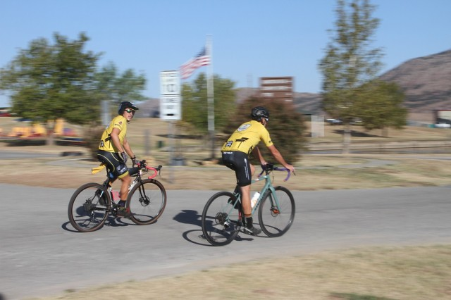 Zach Ellis and Steve Cordes cruise into Lake Elmer Thomas Recreation Area at the conclusion of the Tour de Sill Sept. 23, 2021, at Fort Sill, Oklahoma. Riding the 48-mile route, the duo said they use road cycling to build up for area mountain bike races.