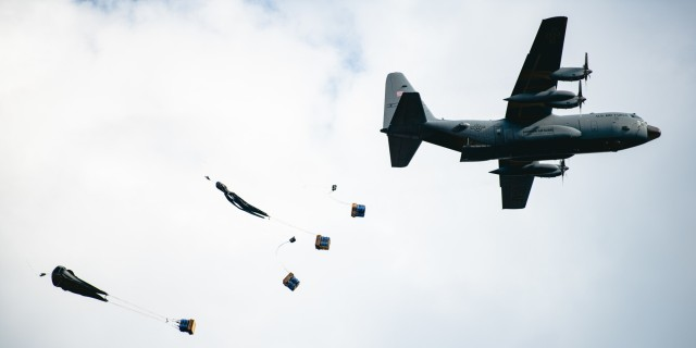 U.S. Army paratroopers assigned to the 54th Brigade Engineer Battalion (Airborne) secure a drop zone for an aerial humanitarian aid package delivery from a C-130 Hercules aircraft during a joint airborne operation with Serbian special operations paratroopers from the 63rd Parachute Brigade as part of Exercise Skybridge 21 at the Medja Training Area in Niš, Serbia on Sept. 16, 2021.  Skybridge 21 is a bi-lateral training exercise taking place in Serbia from Sept. 13 - 17, 2021. Paratroopers of both the 54th Brigade Engineer Battalion (Airborne), 173rd Airborne Brigade and the 63rd Parachute Brigade, Serbian Armed Forces are working alongside supporting components in order to conduct a joint force airborne operation with a training aerial humanitarian aid package delivery. This exercise enhances the interoperability of allied and partner nations by demonstrating the unit's ability to readily respond to any crisis.  The 173d Airborne Brigade is the U.S. Army's Contingency Response Force in Europe, providing rapidly deployable forces to the United States European, Africa and Central Command areas of responsibility. Forward deployed across Italy and Germany, the brigade routinely trains alongside NATO allies and partners to build partnerships and strengthen the alliance.