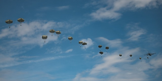 U.S. Army paratroopers assigned to the 54th Brigade Engineer Battalion (Airborne) conduct a joint airborne operation with Serbian special operations paratroopers from the 63rd Parachute Brigade as part of Exercise Skybridge 21 at the Medja Training Area in Niš, Serbia on Sept. 16, 2021.  Skybridge 21 is a bi-lateral training exercise taking place in Serbia from Sept. 13 - 17, 2021. Paratroopers of both the 54th Brigade Engineer Battalion (Airborne), 173rd Airborne Brigade and the 63rd Parachute Brigade, Serbian Armed Forces are working alongside supporting components in order to conduct a joint force airborne operation with a training aerial humanitarian aid package delivery. This exercise enhances the interoperability of allied and partner nations by demonstrating the unit's ability to readily respond to any crisis.  The 173d Airborne Brigade is the U.S. Army's Contingency Response Force in Europe, providing rapidly deployable forces to the United States European, Africa and Central Command areas of responsibility. Forward deployed across Italy and Germany, the brigade routinely trains alongside NATO allies and partners to build partnerships and strengthen the alliance.