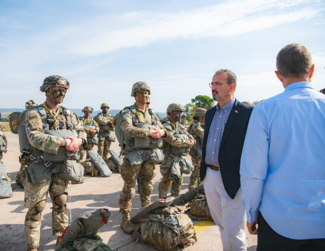 U.S. Army paratroopers assigned to the 54th Brigade Engineer Battalion (Airborne) meets Anthony F. Godfrey, the U.S. Ambassador to Serbia, before a joint airborne operation with Serbian special operations paratroopers from the 63rd Parachute Brigade as part of Exercise Skybridge 21 at the Medja Training Area in Niš, Serbia on Sept. 16, 2021.  Skybridge 21 is a bi-lateral training exercise taking place in Serbia from Sept. 13 - 17, 2021. Paratroopers of both the 54th Brigade Engineer Battalion (Airborne), 173rd Airborne Brigade and the 63rd Parachute Brigade, Serbian Armed Forces are working alongside supporting components in order to conduct a joint force airborne operation with a training aerial humanitarian aid package delivery. This exercise enhances the interoperability of allied and partner nations by demonstrating the unit's ability to readily respond to any crisis.  The 173d Airborne Brigade is the U.S. Army's Contingency Response Force in Europe, providing rapidly deployable forces to the United States European, Africa and Central Command areas of responsibility. Forward deployed across Italy and Germany, the brigade routinely trains alongside NATO allies and partners to build partnerships and strengthen the alliance.