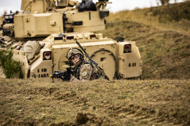 """U.S. Army Sgt. Benjamin Koger, Alpha Company, 1st Battalion, 16th Infantry Regiment """"Iron Rangers,"""" 1st Armored Brigade Combat Team, 1st Infantry Division pulls security during a multinational situational training exercise in Cincu, Romania, Sept. 23, 2021. This training was a part of multiple situational training exercises that U.S. Soldiers executed with multinational partners from Romania, Poland and Portugal. Interoperability is key to the Army Vision, it is critical that the U.S. stands side-by-side with our allies and partners to maintain overmatch and increase lethality against future threats."""