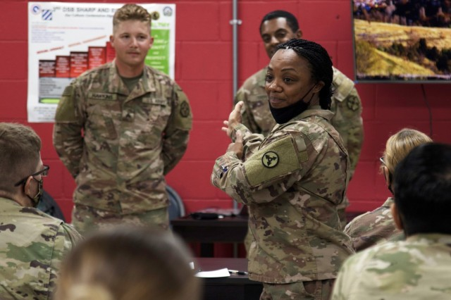 Command Sgt. Maj. Phelicea M. Redd, the senior enlisted advisor for the 1st Theater Sustainment Command Operational Command Post, interacts with Soldiers during a Sexual Harassment/Assault Response and Prevention, or SHARP, ambassador program training session, Sept. 24, 2021, at Camp Arifjan, Kuwait. The two-day course, hosted by the 1st TSC OCP, is designed to provide junior Soldiers with the education and skills necessary to promote a culture change within the Army.