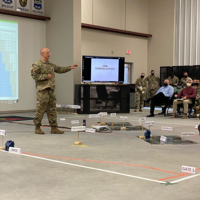 Maj. Clint Brooks, 188th Infantry Brigade chief of operations, briefs installation leadership and staff during a tabletop exercise to rehearse cohort movement for the National Guard southwest border demobilization taking place on Fort Stewart October through November; local Soldiers and families can expect to see impacts with services, especially medical, on post during the demobilization.