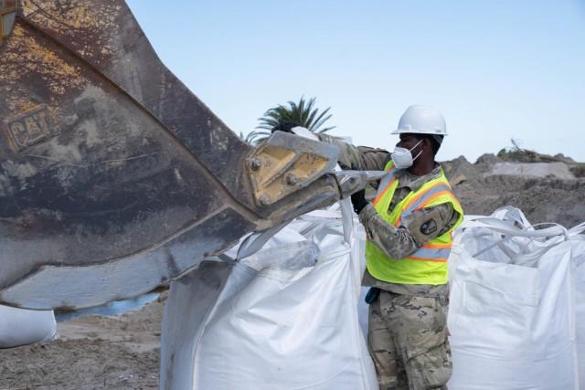 Louisiana Guard shoring up levee damaged by Hurricane Ida