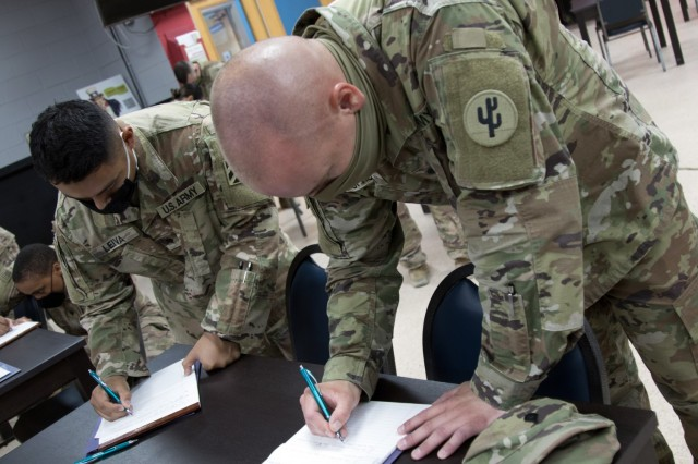 Spc. Manuel M. Leiva and Spc. John J. Ophoven, chemical, biological, radiological, and nuclear specialists assigned to the 3rd Infantry Division Sustainment Brigade, participates in a practical exercise during a Sexual Harassment/Assault Response and Prevention, or SHARP, ambassador program training session, Sept. 23, 2021, at Camp Arifjan, Kuwait. The practical exercise involved Soldiers sharing among themselves their ideas on ways to engage fellow Soldiers about SHARP topics in order to prepare them for their future roles as ambassadors for the program.