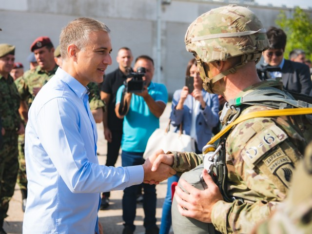 Nebojša Stefanović, the Serbian Minister of Defense, greets Lt. Col. Jefferson Burges, the commander of the 54th Brigade Engineer Battalion (Airborne), before a joint airborne operation with with his battalion and Serbian special operations paratroopers from the 63rd Parachute Brigade as part of Exercise Skybridge 21 at the Medja Training Area in Niš, Serbia on Sept. 16, 2021.   Skybridge 21 is a bi-lateral training exercise taking place in Serbia from Sept. 13 - 17, 2021. Paratroopers of both the 54th Brigade Engineer Battalion (Airborne), 173rd Airborne Brigade and the 63rd Parachute Brigade, Serbian Armed Forces are working alongside supporting components in order to conduct a joint force airborne operation with a training aerial humanitarian aid package delivery. This exercise enhances the interoperability of allied and partner nations by demonstrating the unit's ability to readily respond to any crisis.  The 173d Airborne Brigade is the U.S. Army's Contingency Response Force in Europe, providing rapidly deployable forces to the United States European, Africa and Central Command areas of responsibility. Forward deployed across Italy and Germany, the brigade routinely trains alongside NATO allies and partners to build partnerships and strengthen the alliance.