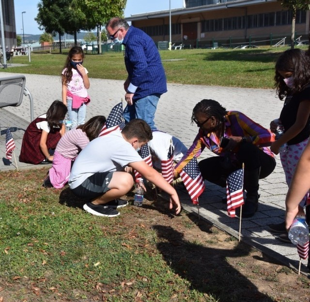 As part of the U.S. Army Garrison Wiesbaden's Honor Walk remembrance of Gold Star Mother's and Family's, children from the Child Development Center planted flags under the Gold Star tree near the physical fitness center Sept. 23.