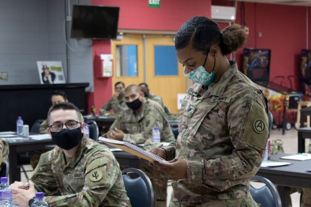 Spc. Myeasha E. Berryman, a human resources specialist assigned to Area Support Group-Kuwait, shares responses from a practical exercise with her classmates during a Sexual Harassment/Assault Response and Prevention, or SHARP, ambassador program training session, Sept. 23, 2021, at Camp Arifjan, Kuwait. The two-day course, hosted by the 1st Theater Sustainment Command Operational Command Post, is designed to provide junior Soldiers with the education and skills necessary to promote a culture change within the Army.