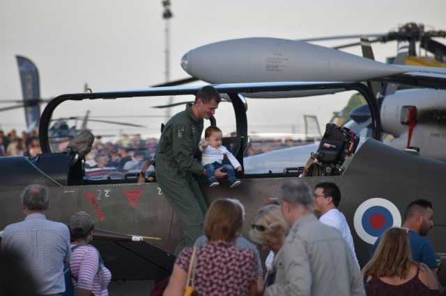 Flight crews show local community members around their aircrafts as part of the Chièvres Air Fest, Sept. 25, 2021 at Chièvres Air Base, Belgium. The Saturday event was the first time the base was opened to the general public in more than 25years. (U.S. Army photo by Bryan Gatchell, USAG Benelux Public Affairs)