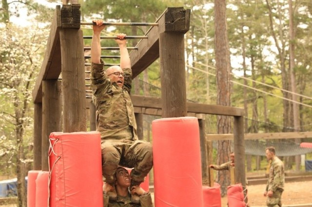 Spc. Daniel P. Bush Jr., a civil affairs specialist with the 418th Civil Affairs Battalion, and Staff Sgt. Natalie N. Tedesco, a psychological operations specialist with the 303rd Psychological Operations Company, go through the confidence course at Fort Jackson, S.C., April 9, 2021. Twenty-four finalists representing 12 Army commands will complete in person at the Army-level competition to determine the service's top Soldier and noncommissioned officer.