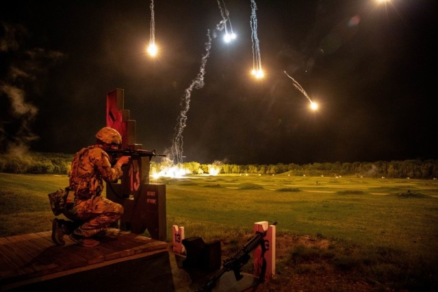A Soldier engages targets at night during the 2021 Army Reserve Best Warrior Competition at Fort McCoy, Wis., May 25, 2021. Twenty-four finalists representing 12 Army commands will complete in person at the Army-level competition to determine the service's top Soldier and noncommissioned officer.