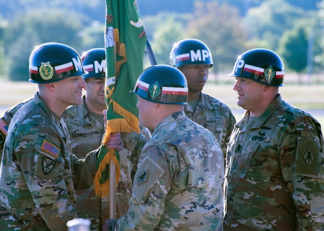 Incoming Military Police Regimental Command Sgt. Maj. Shawn Klosterman (left) takes the colors from Col. Steven Yamashita, U.S. Army Military Police School assistant commandant, during a change-of-responsibility ceremony Sept. 23 on Gammon Field, as outgoing MP Regimental Command Sgt. Maj. Michael Bennett looks on. The ceremony took place during MP Regimental Week – the MP Corps celebrated its 80th anniversary on Sept. 26.