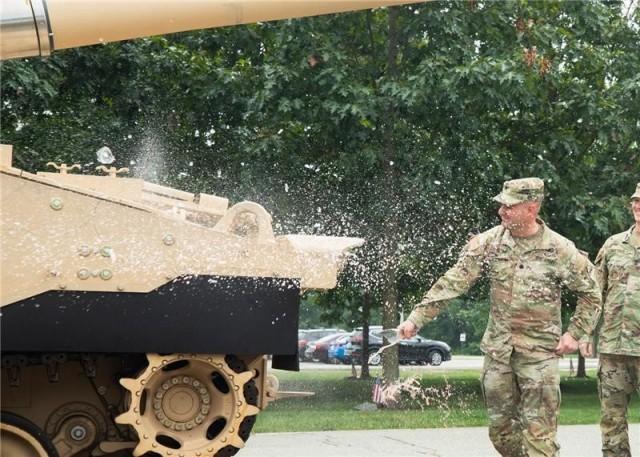 Lt. Col. Stefan Hutnik, commander of the 4th Battalion, 27th Field Artillery, christens an Extended