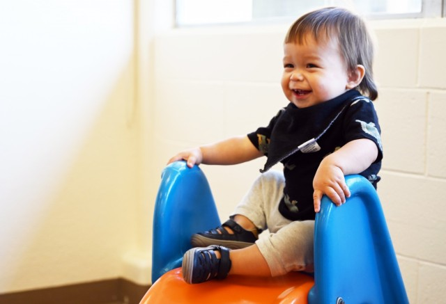 Gideon Hawley, 1, gets ready to go down a slide during the weekly playgroup at Army Community Service, Ord Military Community, Calif., Sept. 28.