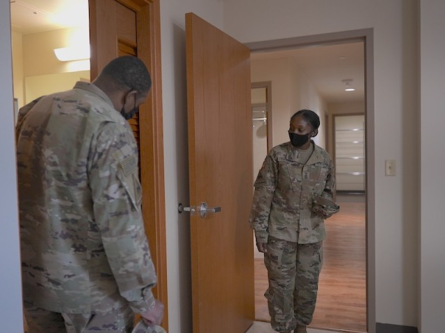 Sgt. Maj. Deaquennette Thomas and Master Sgt. Dane Thomas tour an apartment complex at USAG Daegu during an open house Oct 1, 2021. The military couple is looking to move to Camp Walker from their current off-post accommodations.