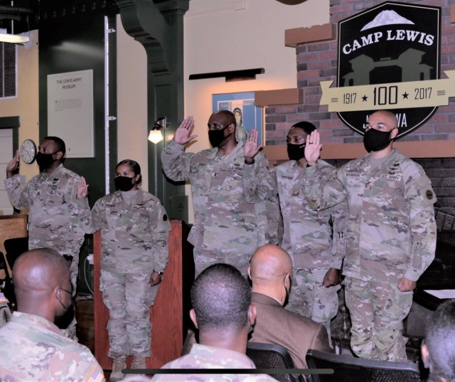 U.S. Army officers and warrant officers are sworn in as executive board members for JBLM Rainier ROCKS, the newly-established chapter of ROCKS, Inc., during a ceremony at Joint Base Lewis-McChord, Wash., Sept. 30, 2021. ROCKS, Inc., is a nonprofit organization providing mentorship, scholarship and fellowship for junior officers and cadets. (U.S. Army photo by Spc. Richard Carlisi, I Corps)