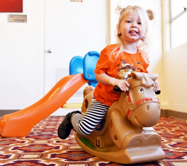 Rosie Hardin, 2, plays on a rocking horse during the weekly playgroup at Army Community Service, Ord Military Community, Calif., Sept. 28.