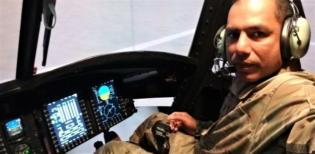 Chief Warrant Officer 3 Mohomed Azeez, a Troop Program Unit Soldier assigned to the 94th Training Division – Force Sustainment (TD-FS) Headquarters, can be seen in a flight simulator during his time as a ground maintenance officer while assigned to the 12th Combat Aviation Brigade in Katterbach Kaserne,Germany. (Photo courtesy of Chief Warrant Officer 3 Mohomed Azeez, G4, 94th TD-FS HHC)
