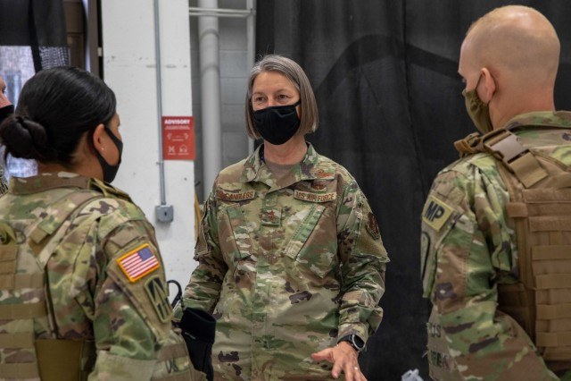 Air Force Maj. Gen. Sherrie McCandless, the D.C. National Guard commanding general, stands beside he