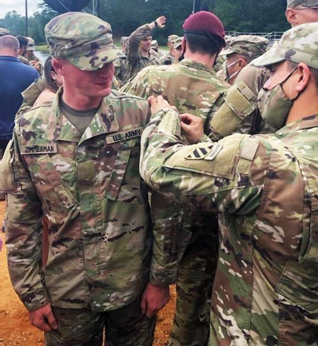 """First Sgt. Betanzos, right, assigned to Headquarters and Headquarters Battalion, 3rd Infantry Division, pins the Ranger Tab on Sgt. Caleb Zimmerman, left, both assigned to 3rd Battalion, 67th Armor Regiment, """"Spartan Brigade,"""" 2nd Armored Brigade Combat Team, 3rd Infantry Division, after completing the course at Fort Benning, Georgia, Aug. 27, 2021. 2nd ABCT, 3rd ID,  is pushing and supporting its most junior leaders to become experts in their craft early to then lead and affect readiness. (Courtesy photo)"""