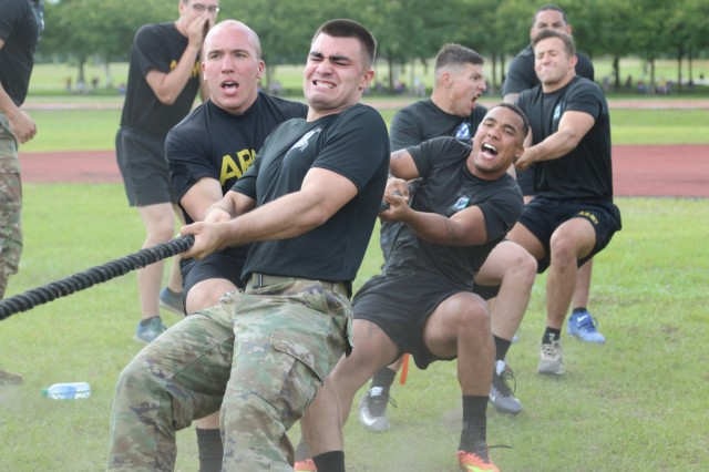 """Soldiers assigned to 1st Battalion, 28th Infantry Regiment, 3rd Infantry Division, from Fort Benning, Georgia, compete in a tug-of-war event during Marne Week on Fort Stewart, Georgia, May 17, 2021. Marne week events, such as sporting competitions, are designed to connect and celebrate the proud lineage of the Dogface Solder and the """"Rock of the Marne."""" (U.S. Army Photo by Sgt. Reva Catholic)"""