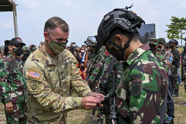 U.S. Army Gen. Charles Flynn, commanding general of the U.S. Army Pacific, pins airborne wings on a Soldier from the Indonesian Armed Forces after completing the airborne operations exercise, on August 4, 2021. Garuda Shield 21 is a two-week joint-exercise between the United States Army and Tentara Nasional Indonesia (TNI-AD Indonesia Armed Forces). The purpose of this joint-exercise is to enhance and enrich the jungle warfare ability of both the U.S. Army and Indonesian Army. (U.S. Army photo by Danielle ODonnell) (Photo Credit: Danielle O'Donnell)